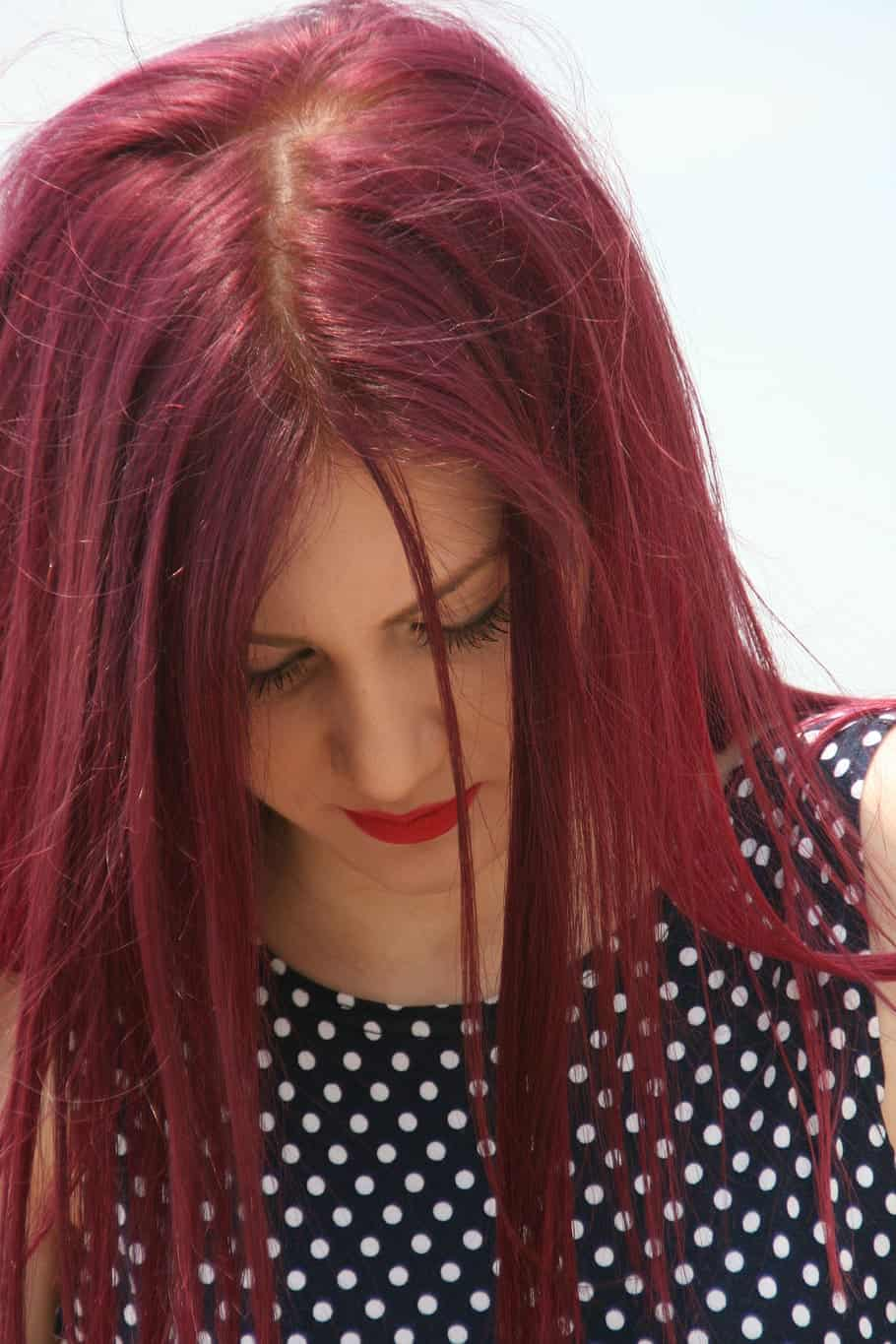 A Tint Of Violet Blends With Light Red Hair After Treatment.